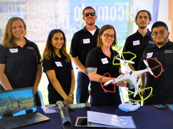A group of University of Arizona students demonstrates drone technology they created for use in agriculture.