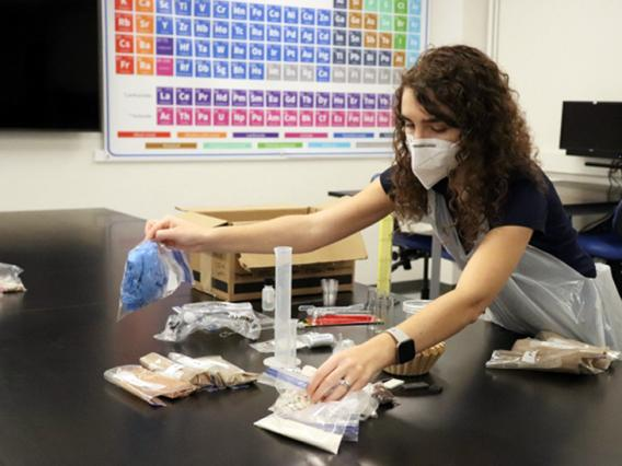 A woman works on a project in classroom lab.